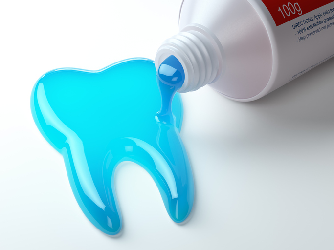 Toothpaste in the shape of tooth coming out from toothpaste tube. Brushing teeth dental concept.